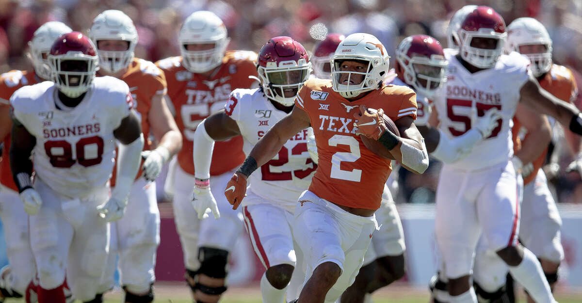 After being recruited to Texas as a quarterback, Roschon Johnson (2) had a crash course in transition to running back as a freshman.
