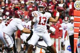 COLLEGE STATION, TEXAS - OCTOBER 12: Quarterback Tua Tagovailoa #13 of the Alabama Crimson Tide throws a pass during the game against Texas A&M Aggies at Kyle Field on October 12, 2019 in College Station, Texas. (Photo by Logan Riely/Getty Images)