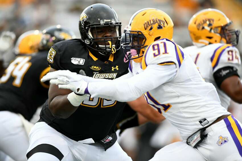 UAlbany defensive end Anthony Lang (91) had a quarterback sack and four hurries in Saturday's 38-21 win at Towson. (ENP Photography)
