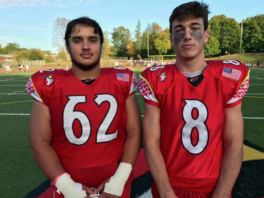 Senior captains Eddy Iuteri, left and Evan Weigold helped lead the Greenwich football team's defense in its 50-6 win vs. Westhill on Saturday, October 12, 2019. Photo: David Fierro /Hearst Connecticut Media