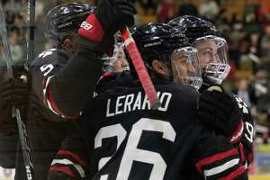 Northeastern hockey players celebrate their second goal against Union College during a game Saturday, Oct. 12, 2019, at Messa Rink in Schenectady, N.Y. (Jenn March, Special to the Times Union )