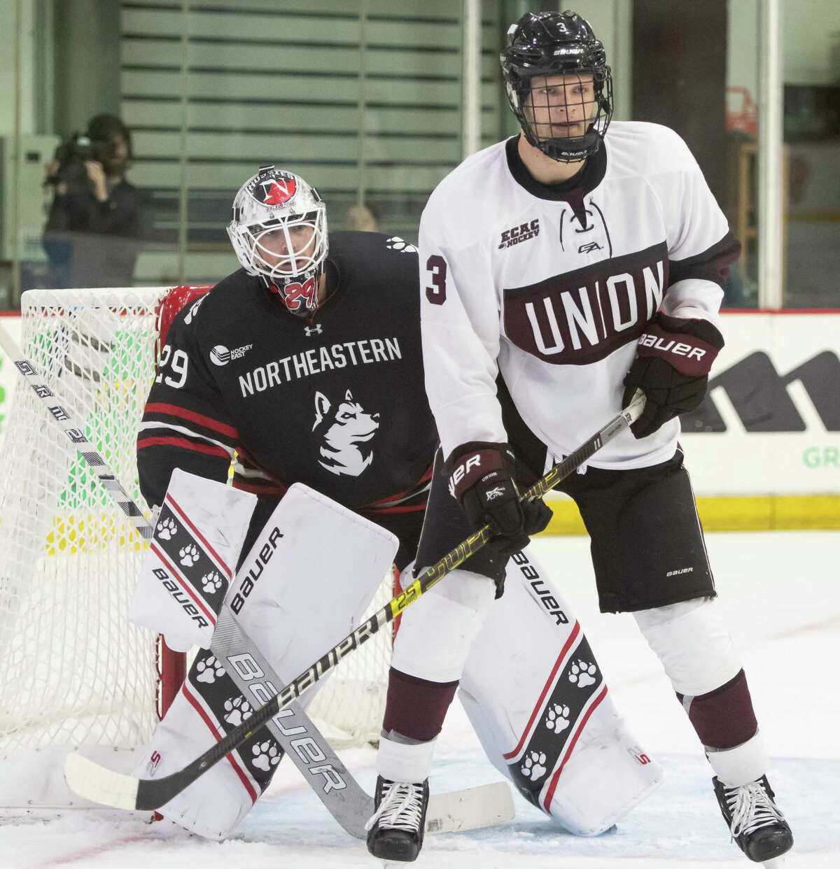 Union College announced Tuesday that it was canceling the seasons of its men's and women's hockey teams because of the ongoing coronavirus pandemic. In this photograph, Union forward Colin Schmidt screens Northeastern goalie Craig Pantano during a game Saturday, Oct. 12, 2019, at Messa Rink in Schenectady, N.Y. (Jenn March, Special to the Times Union )