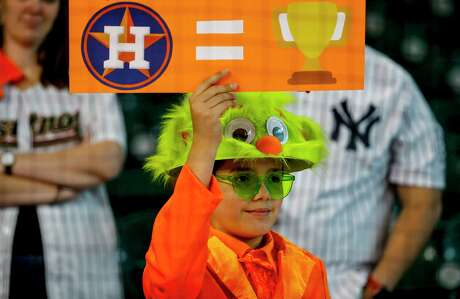 A young Astros fan holds up a sign during batting practice before Game 1 of the American League Championship Series at Minute Maid Park on Saturday, Oct. 12, 2019, in Houston.