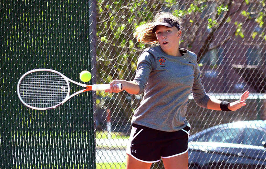 Edwardsville's Hannah Colbert makes a forehand return during her No. 3 singles match Saturday in the Southwestern Conference Tournament at the EHS Tennis Center. Photo: Scott Marion/The Intelligencer