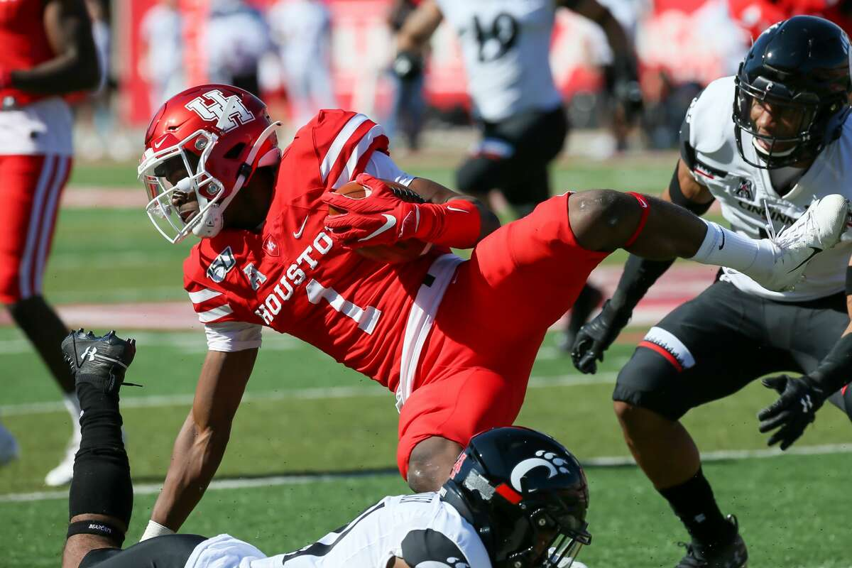 Houston Cougars linebacker Eyabi Anoma (1) returns the punt during the second quarter of the college football game between the Cincinnati Bearcats and Houston Cougars at TDECU Stadium, October 12, 2019 in Houston, TX.