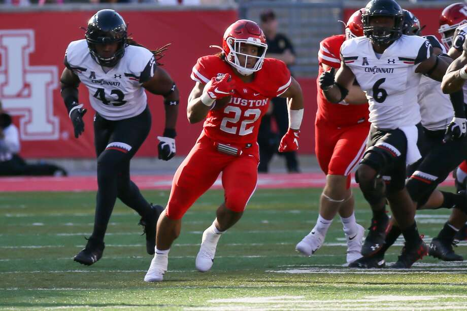 PHOTOS: UH vs. Cincinnati  Houston Cougars running back Kyle Porter (22) carries the ball during the fourth quarter of the college football game between the Cincinnati Bearcats and Houston Cougars at TDECU Stadium, October 12, 2019 in Houston, TX. >>>See more photos from the Cougars' game against Cincinnati last week ...  Photo: Leslie Plaza Johnson/Contributor