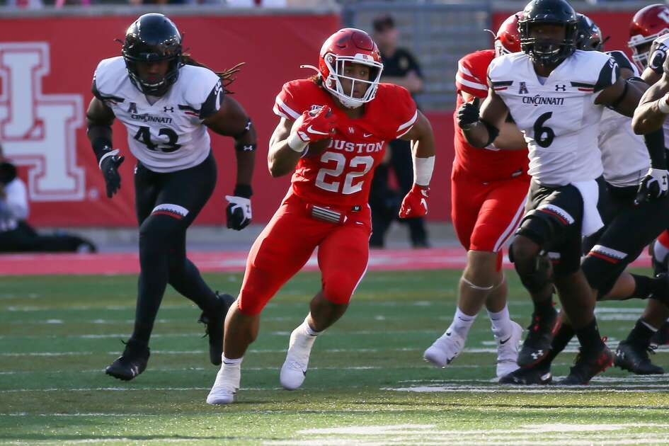 Houston Cougars running back Kyle Porter (22) carries the ball during the fourth quarter of the college football game between the Cincinnati Bearcats and Houston Cougars at TDECU Stadium, October 12, 2019 in Houston, TX.