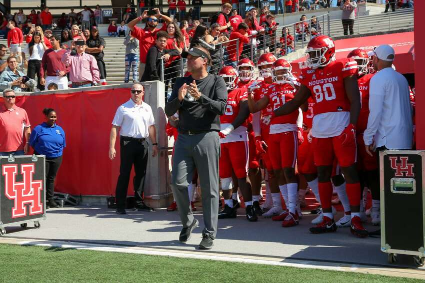 Houston Cougars head coach Dana Holgren waits to lead the team into the field before the college football game between the Cincinnati Bearcats and Houston Cougars at TDECU Stadium, October 12, 2019 in Houston, TX.
