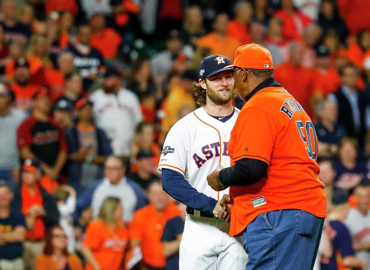 Houston Astros pitcher Gerrit Cole (45) shakes the hand of former Astros pitcher J.R. Richard after Richard threw out the the ceremonial first pitch before Game 1 of the American League Championship Series at Minute Maid Park on Saturday, Oct. 12, 2019, in Houston.