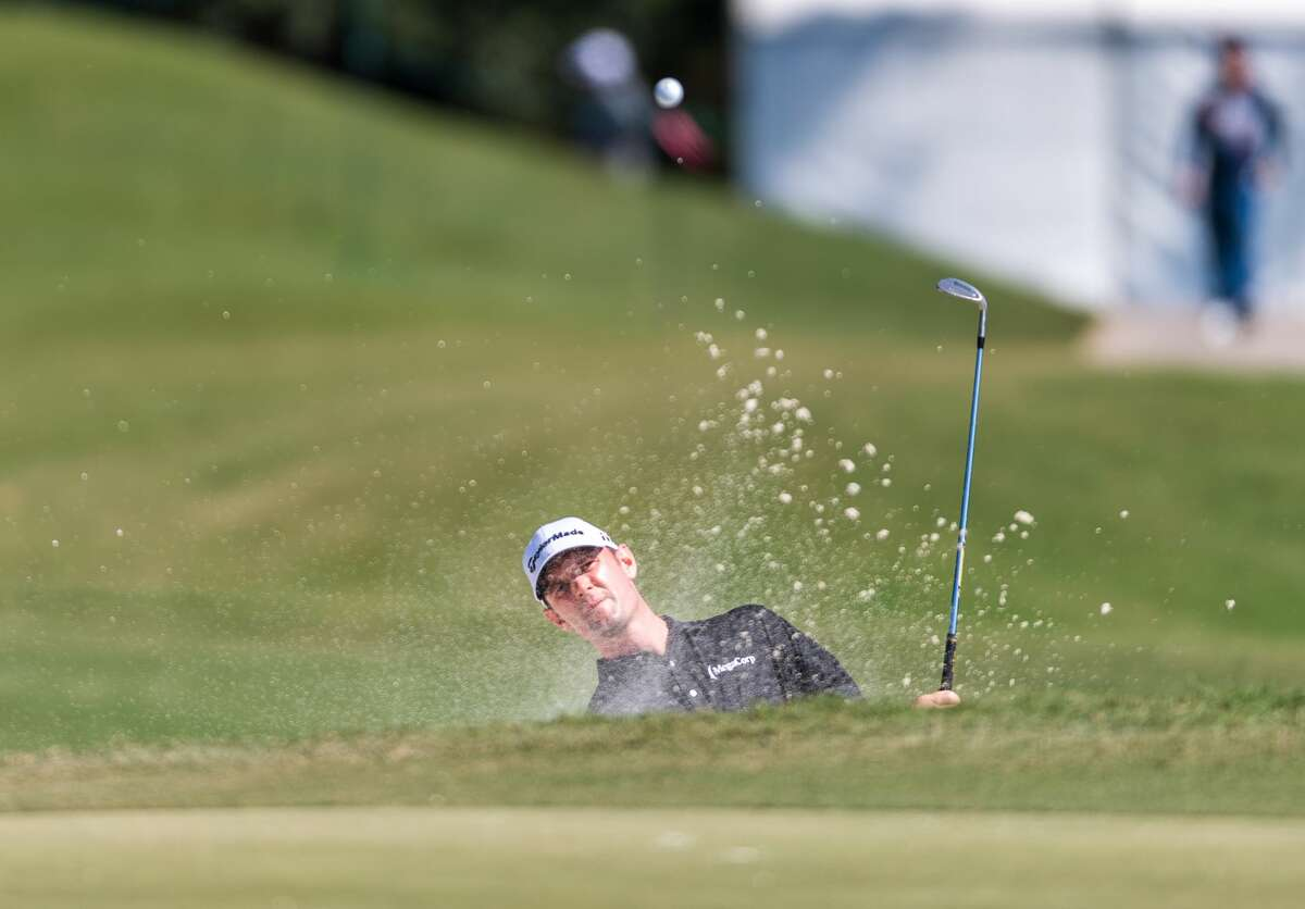 Wes Roach hits out of a sand trap on the 2nd green during the Houston Open at the Golf Club of Houston in Humble Texas on Saturday, October 12, 2019.
