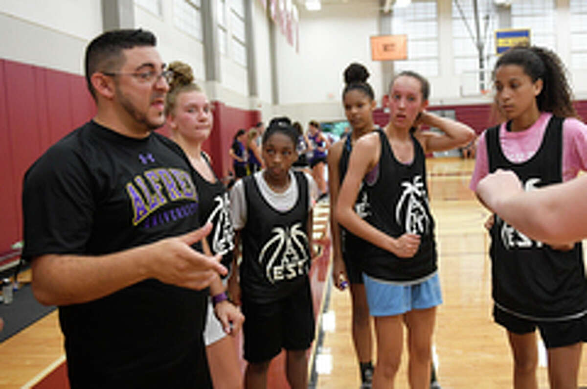 Next Big Thing coach Mike Moskowitz instructs his players against Power Up during a Empire State Takeover girls' basketball league game Wednesday, July 17, 2019, at Union College in Schenectady, N.Y. (Hans Pennink / Special to the Times Union)