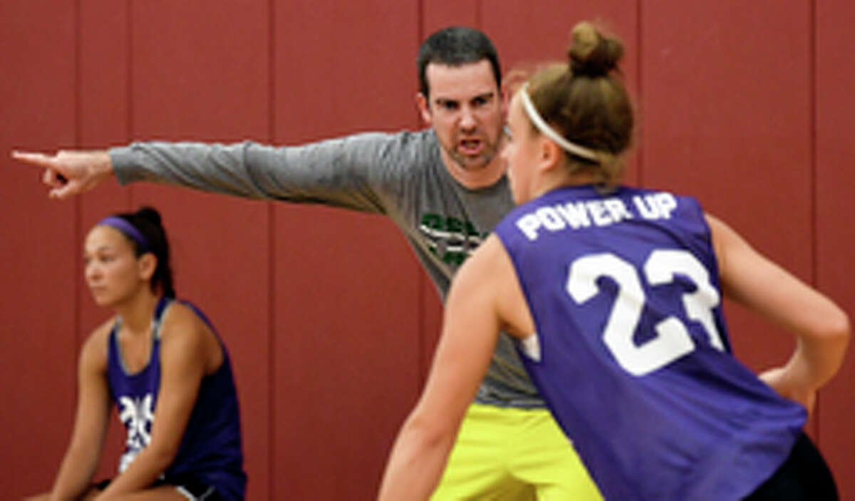 Power Up coach Sean Pinkerton instructs Dolly Cairns of Saratoga Springs against Next Big Things during a Empire State Takeover girls' basketball league game Wednesday, July 17, 2019, at Union College in Schenectady, N.Y. (Hans Pennink / Special to the Times Union)