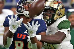 UTSA tight end Carlos Strickland makes a reception as UAB safety Dy'jonn Turner defends in first half action on Saturday, October 12, 2019.