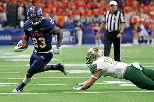 UtSA running back Sincere McCormick leaves a UAB in the turn in first half action on Saturday, October 12, 2019.