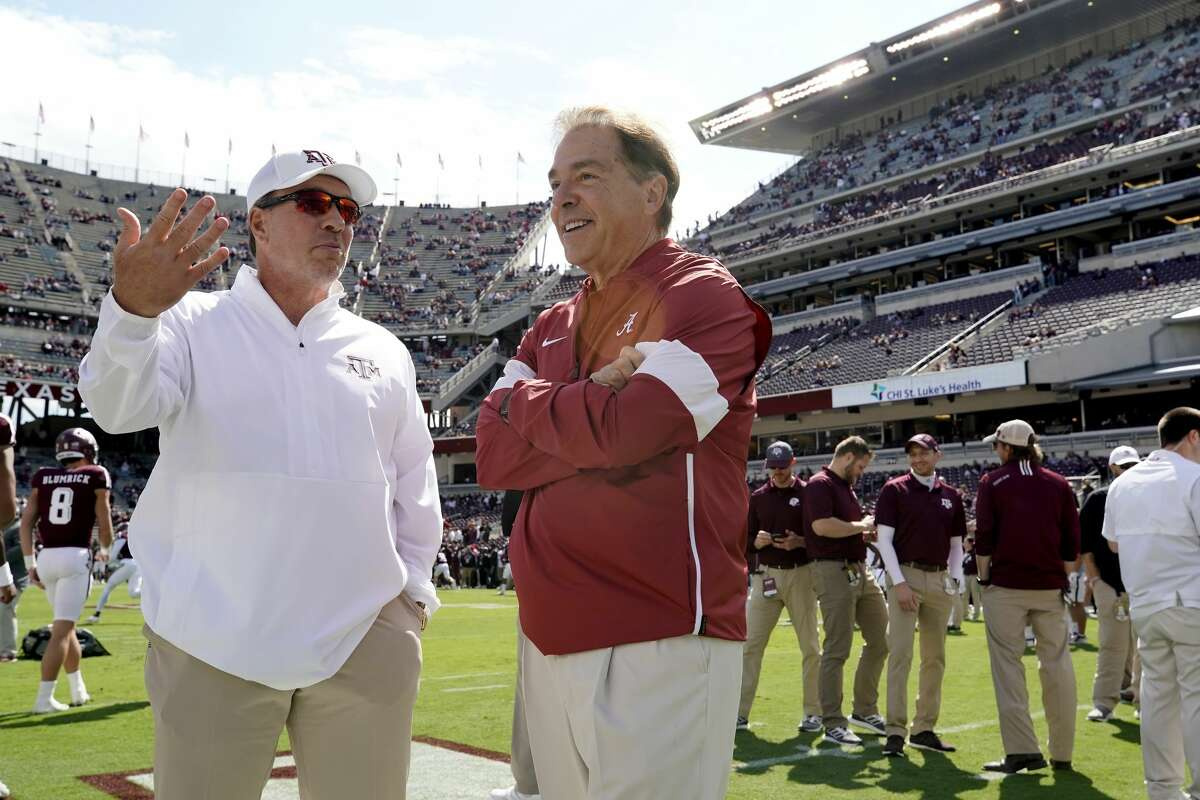 Texas A&M head coach Jimbo Fisher, left, talks to Alabama head coach Nick Saban before the start of an NCAA college football game, Saturday, Oct. 12, 2019, in College Station, Texas. (AP Photo/Sam Craft)