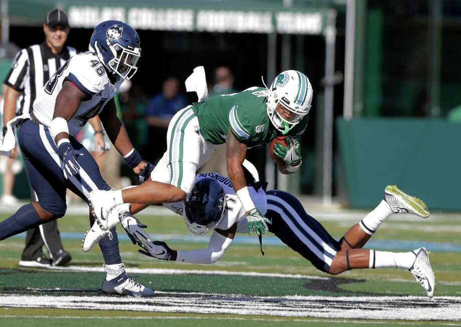 UConn defensive back Oneil Robinson (17) tackles Tulane running back Amare Jones during Saturday's 49-7 loss at Yulman Stadium in New Orleans. Photo: A.J. Sisco / Associated Press / The Advocate