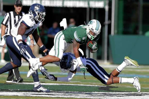 UConn defensive back Oneil Robinson (17) tackles Tulane running back Amare Jones during Saturday's 49-7 loss at Yulman Stadium in New Orleans.
