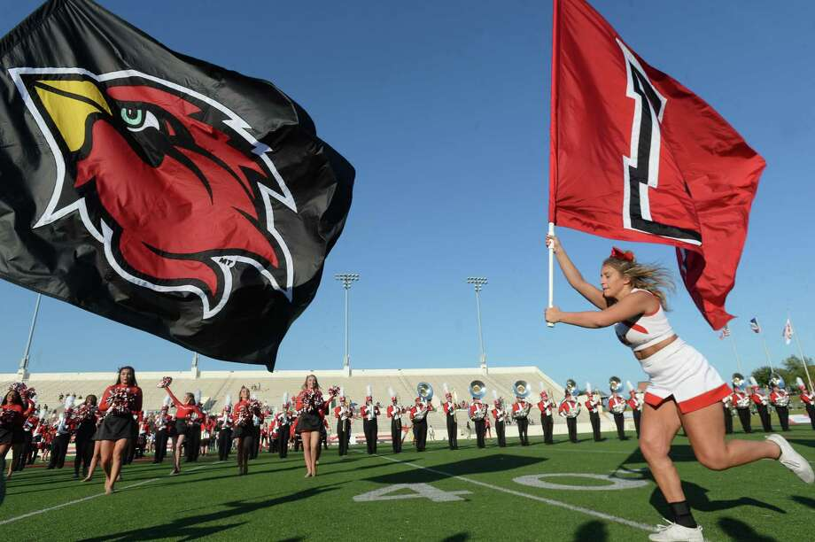 Lamar's cheerleaders run the flags as they get ready to face Mississippi Valley State during their home game Saturday.  Photo taken Saturday, September 7, 2019 Kim Brent/The Enterprise Photo: Kim Brent / The Enterprise / BEN