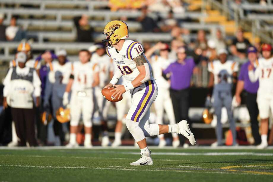UAlbany quarterback Jeff Undercuffler looks for a taget while on the move against Towson in their CAA game on Saturday, Oct. 12, 2019, at Johnny Unitas Stadium in Towson, Md. (ENP Photography)