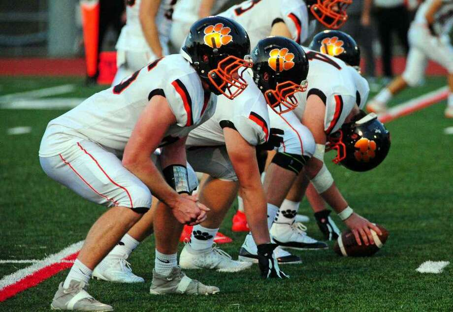 Ridgefield's offensive line (shown in a game earlier this season) was impressive in Saturday's 42-0 road win over Chatham (N.J.). Photo: Christian Abraham / Hearst Connecticut Media