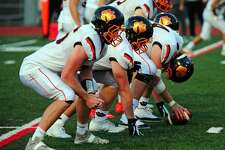 Ridgefield's offensive line (shown in a game earlier this season) was impressive in Saturday's 42-0 road win over Chatham (N.J.).
