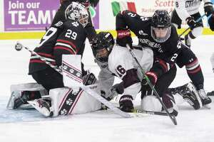 Union forward Christian Sanda falls beneath Northeastern defenseman Jordan Harris as the rebound flies past the goal during a game Saturday, Oct. 12, 2019, at Messa Rink in Schenectady, N.Y. (Jenn March, Special to the Times Union )