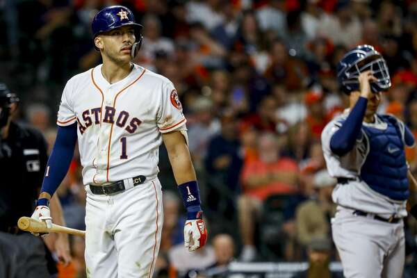Houston Astros shortstop Carlos Correa (1) strikes out swinging during the eighth inning of Game 1 of the American League Championship Series at Minute Maid Park on Saturday, Oct. 12, 2019, in Houston.