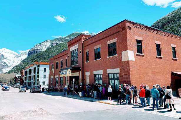 "A sold-out crowd watches ""Finding Home in Boomtown"" at the Mountainfilm Festival in Telluride, Colorado."