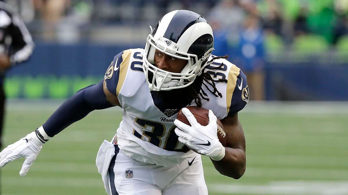 Los Angeles Rams running back Todd Gurley carries the ball during an NFL football game against the Seattle Seahawks, Thursday, Oct. 3, 2019, in Seattle. (AP Photo/Elaine Thompson)