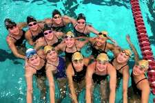 Pictured are the Midland High and Dow High swimmers who competed at the MISCA Invitational on Saturday at Calvin University in Grand Rapids. (Photo provided)