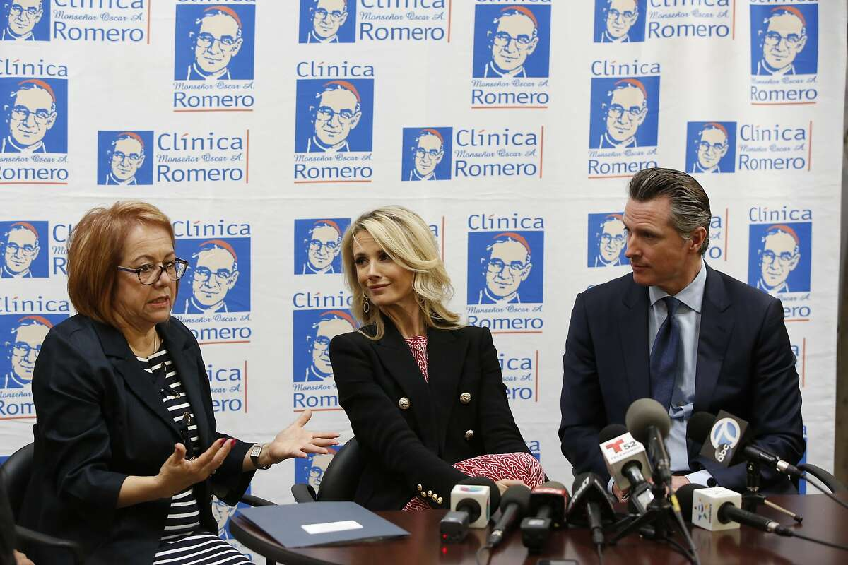 California Sen. Maria Elena Durazo, D-Los Angeles, left, participates with Jennifer Siebel Newsom, and her husband, California Gov. Gavin Newsom at a roundtable discussion with Central American community leaders at the Clinica Monsenor Oscar Romero in Los Angeles, Thursday, March 28, 2019. Newsom said Thursday he will travel to El Salvador in April to discuss the poverty and violence that's causing waves of migrants to seek asylum in the United States. (AP Photo/Damian Dovarganes)
