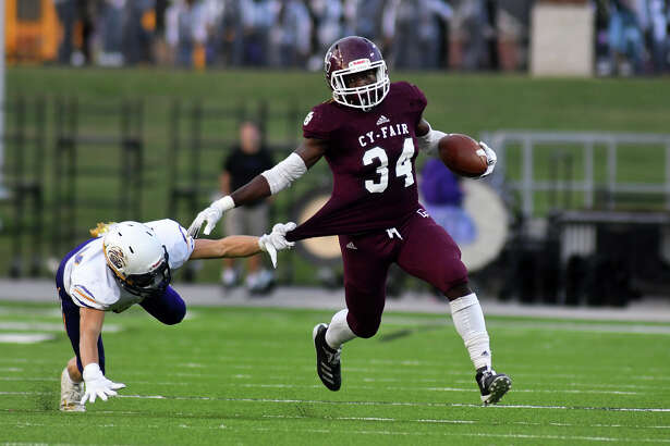 Cy-Fair junior running back L.J. Johnson (34) breaks away from Jersey Village senior defensive back Christian Davis on a running play in the 2nd quarter of their District 17-6A matchup at Pridgeon Stadium in Cypress on Oct. 12, 2019.