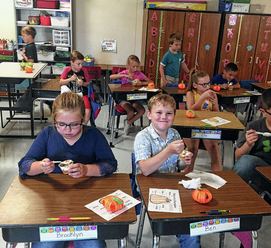 Brooklyn Mulford (front left) and Ben Musgrave enjoy their pumpkin pie treat along with other students in Mrs. Havens' class. Photo: Photo Provided