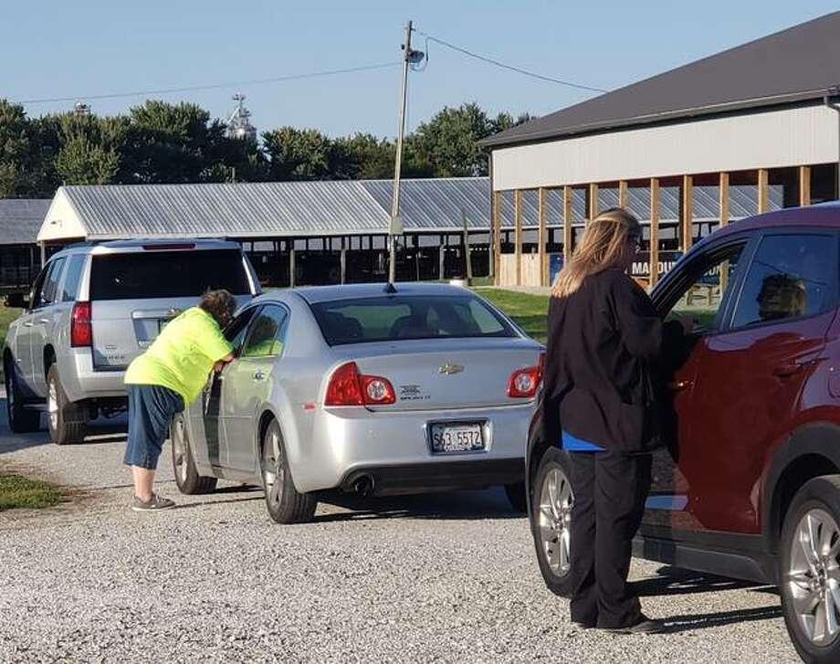 About 100 cars drove through the Macoupin County Public Health Department's annual flu clinic Tuesday at the Macoupin County Fairgrounds.