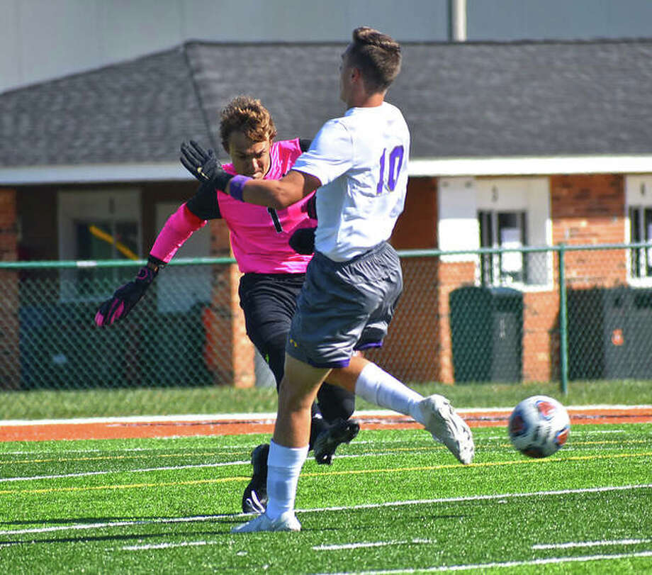Edwardsville keeper Tyler Frolik clears an attempted through ball away from CBC forward Luca Bartoni in the first half Saturday inside the District 7 Sports Complex. Photo: Matt Kamp|The Intelligencer