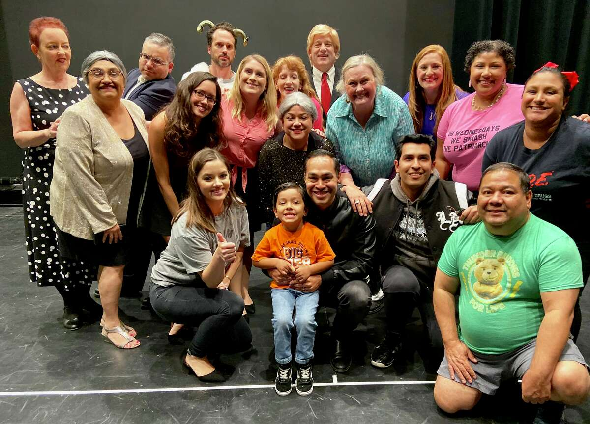 Democratic presidential candidate and San Antonio native, Julián Castro, poses with cast members of the 2019 Gridiron show before the show on Saturday, Oct. 12, 2019.