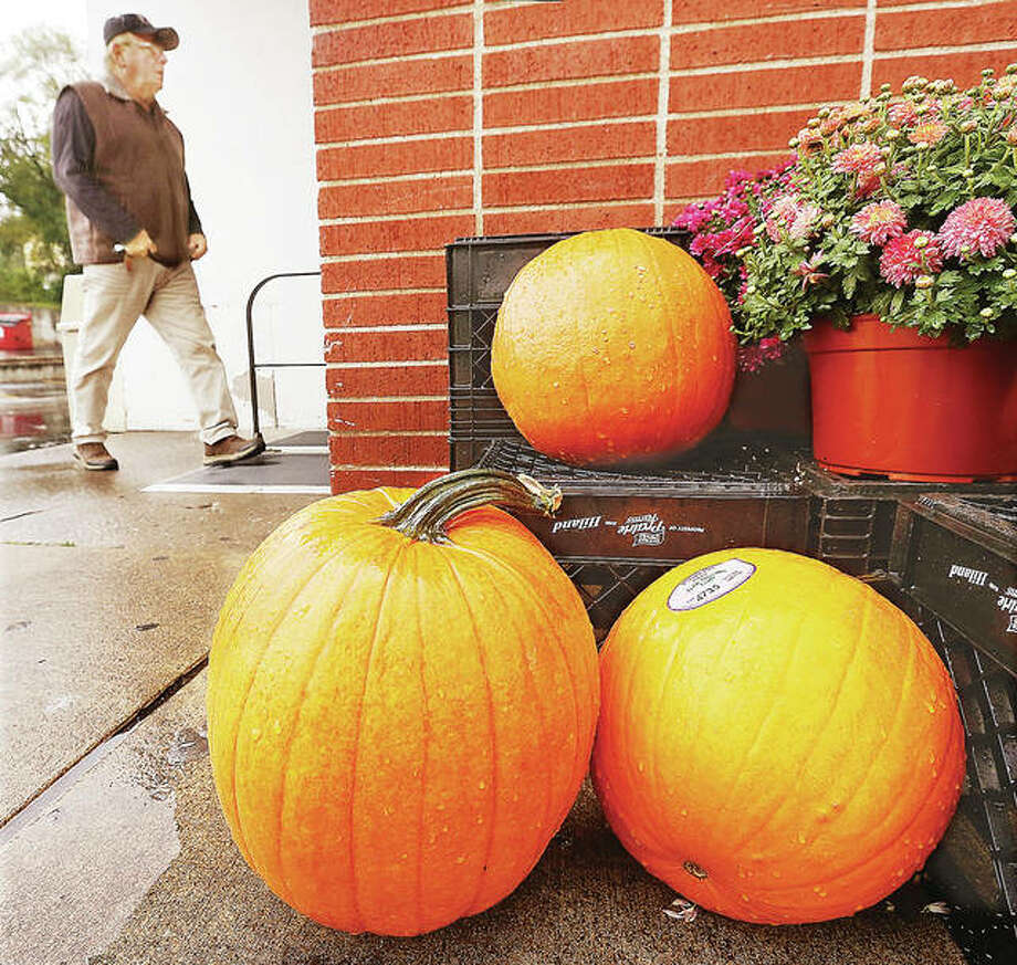 A customer walks into the Schwegel's grocery store at 901 Alby St. in Alton past nearly 30 pumpkins for sale out front. Despite a late start getting crops planted, the Illinois pumpkin crop is looking good this fall. Illinois' pumpkin industry is worth approximately $200 million, with the the state producing nearly 90 percent of the nation's canned pumpkin supply.