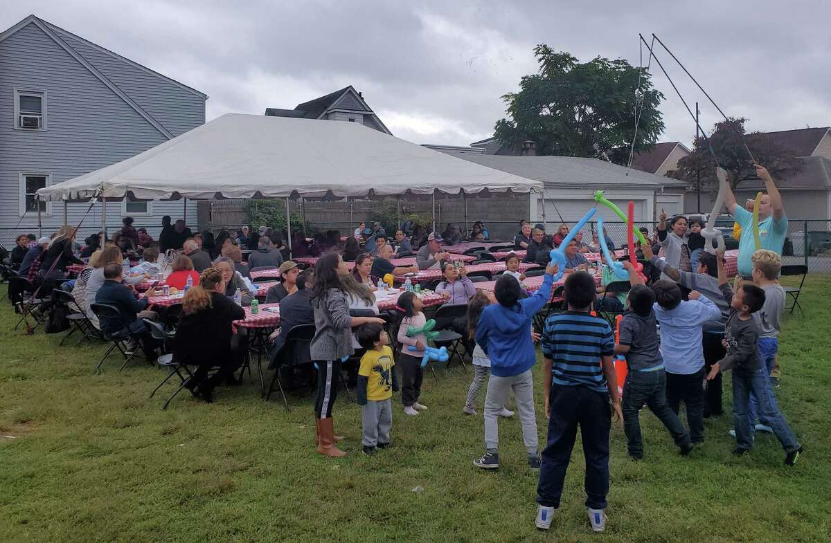 Kids sword-fight with balloon art at the St. Roch Church picnic on Oct. 6.