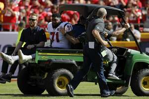An injured Houston Texans offensive guard Tytus Howard (71) is wheeled off the field during the second half of an NFL football game against the Kansas City Chiefs in Kansas City, Mo., Sunday, Oct. 13, 2019. (AP Photo/Colin E. Braley)