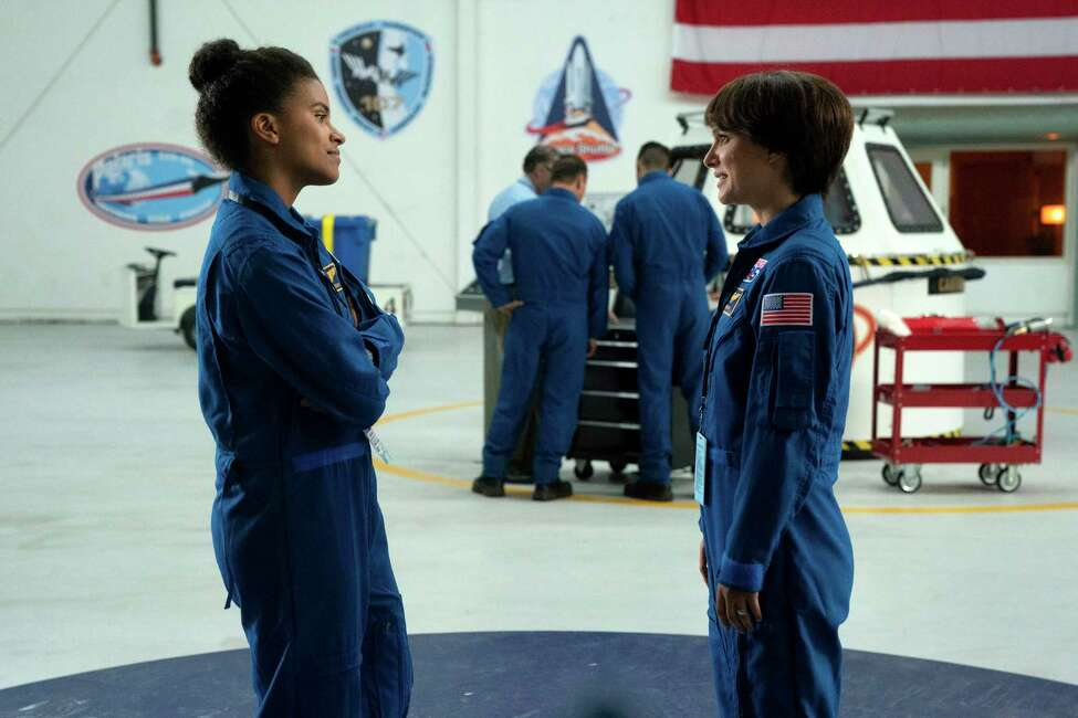This image released by Fox Searchlight Pictures shows Zazie Beetz, left, and Natalie Portman in a scene from