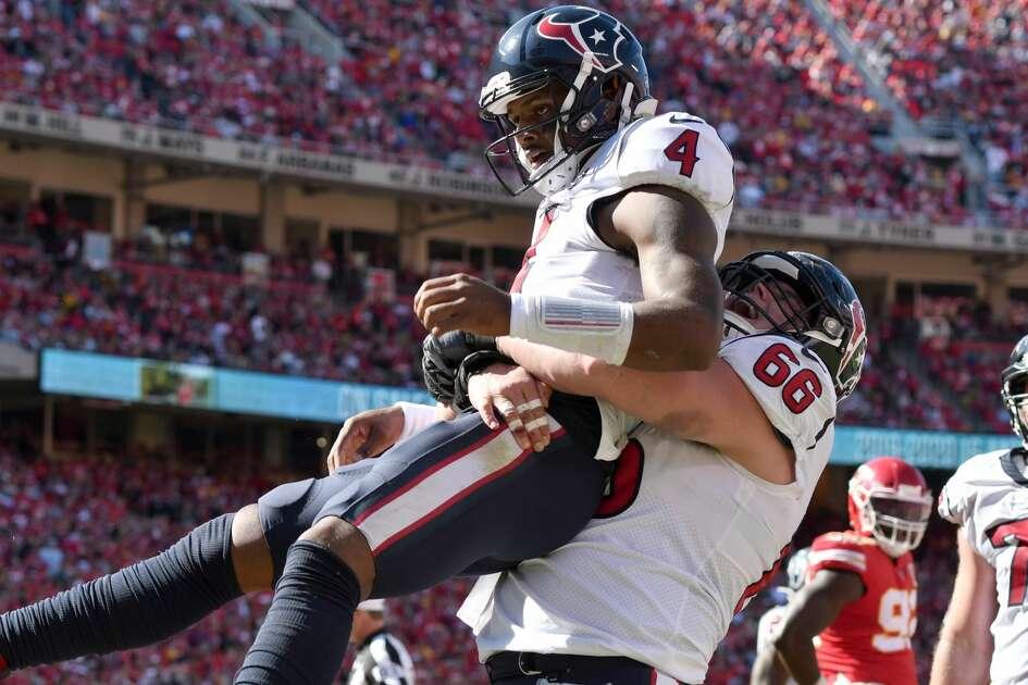 Houston Texans quarterback Deshaun Watson (4) celebrates his touchdown against the Kansas City Chiefs with center Nick Martin (66) during the second half of an NFL football game in Kansas City, Mo., Sunday, Oct. 13, 2019. (AP Photo/Ed Zurga)