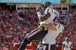Houston Texans quarterback Deshaun Watson (4) is hoisted by center Nick Martin (66) after scoring the game-winning touchdown on a one-yard rush against the Kansas City Chiefs during the fourth quarter of an NFL game at Arrowhead Stadium Sunday, Oct. 13, 2019, in Kansas City, Mo. The Texans won 31-24.