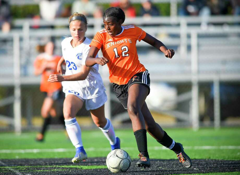 Stamford's Chanille Assevero, right, scored a pair of goals in two separate games last week. Photo: Matthew Brown / Hearst Connecticut Media / Stamford Advocate