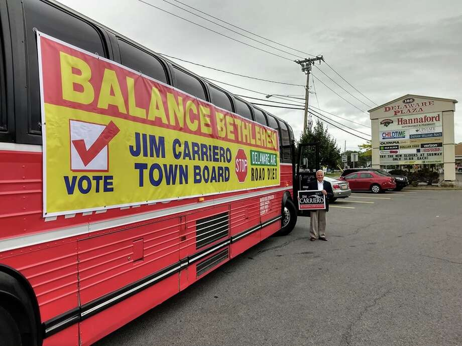 "Jim Carriero, a candidate for Bethlehem Town Board, has been utilizing a tomato-red bus to advertise his campaign and call for an end to the Delaware Avenue ""road diet"" plan. Photo: Courtesy Of Steve Peterson"