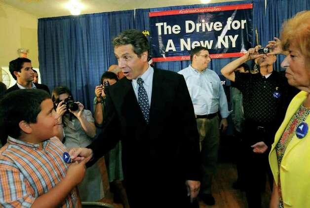 "Democratic candidate for governor Andrew Cuomo asks in a joking manner ""whose that on the pin"" as he greets young fan ten-year-old Giovanie Adorno of Amsterdam Friday during a campaign stop at the Amsterdam Elks in Amsterdam, New York . ( Michael P. Farrell / Times Union ) Photo: Michael P. Farrell"