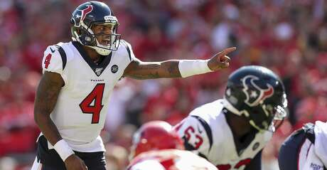 Houston Texans quarterback Deshaun Watson (4) makes a pre-snap adjustment against the Kansas City Chiefs during the third quarter of an NFL game at Arrowhead Stadium Sunday, Oct. 13, 2019, in Kansas City, Mo. The Texans won 31-24.