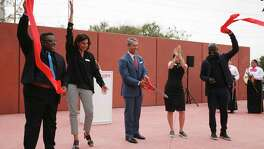 San Antonio Mayor Ron Nirenberg cuts the ribbon opening Ruby City On Sunday. Joining Nirenberg are, from left, filmmaker and installation artist Isaac Julien; Linda Pace Foundation trustees Kathryn Kanjo and Laura B. Wright; and Sir David Adjaye, the architect who designed the building.