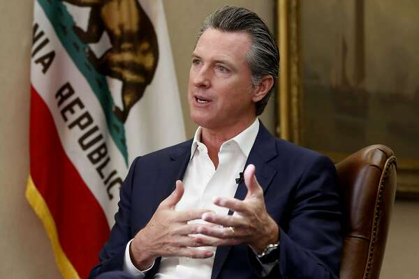 "Calling President Donald Trump ""completely corrupt"" California Gov. Gavin Newsom said Trump should be removed from office by Congress, during an interview in Sacramento, Calif., Tuesday, Oct. 8, 2019. But Newsom said that with Republicans in control of the U.S. Senate the best way to boot Trump from office is at the ballot box. (AP Photo/Rich Pedroncelli)"