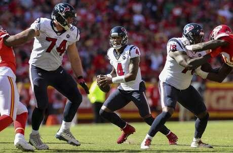 Houston Texans quarterback Deshaun Watson (4) looks for an open receiver against the Kansas City Chiefs during the third quarter of an NFL game at Arrowhead Stadium Sunday, Oct. 13, 2019, in Kansas City, Mo. The Texans won 31-24.