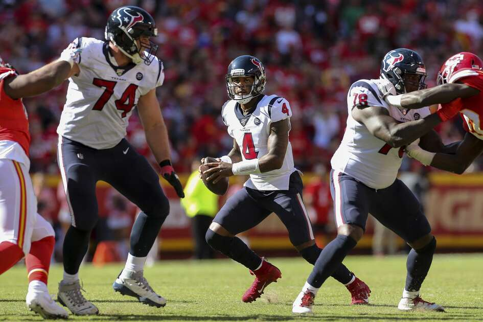 Houston Texans quarterback Deshaun Watson (4) looks for an open receiver against the Kansas City Chiefs during the third quarter of an NFL game at Arrowhead Stadium Sunday, Oct. 13, 2019, in Kansas City, Mo. The Texans won 31-24.